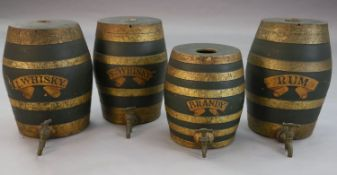 A set of four Victorian painted stoneware spirit barrels, I.Whisky, SCH.Whisky, Rum and Brandy,