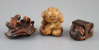 Three Japanese boxwood or cherry netsuke of oni, Meiji period, the first depicting a seated oni