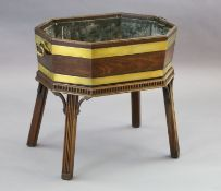 A George III brass bound mahogany wine cooler, of elongated octagonal form with metal liner, on a