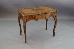 A late 19th century French ormolu mounted walnut, rosewood and marquetry writing table, with