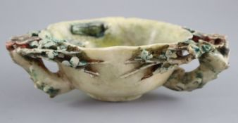 A Chinese polychrome soapstone libation cup or brush washer, probably Kangxi period, carved in