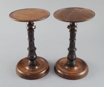 A pair of George III mahogany and ebony adjustable candle stands, with telescopic stems height 8.
