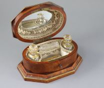 A late 18th century Dutch brass bound kingwood necessaire, with gilt brass mounts, the lid opening