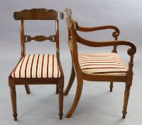 A set of ten William IV mahogany dining chairs including two carvers, with scroll carved frames