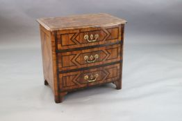 A French Regence olivewood and rosewood bowfront commode, c.1725, with parquetry decoration and