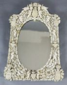 A 19th century Dieppe ivory wall mirror, of arched rectangular form with oval plate, applied with