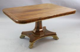 A Regency brass mounted rosewood breakfast table, with rounded rectangular tilt top, brass stringing