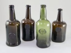 Four All Souls Common Room green glass sealed wine bottles, second half 18th century, in olive