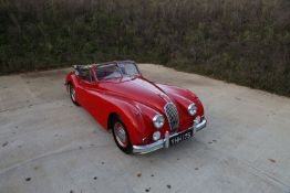 A 1956 Jaguar XK140 DHC The Jaguar XK140 was manufactured by Jaguar between 1954 and 1957 as the