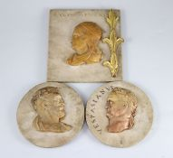 After the antique. A pair of early 19th century Italian marble roundels, carved with the heads of