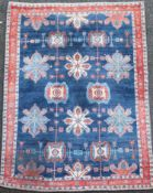 An Iranian Loribaft blue ground rug, with field of floral motifs and three row border, 7ft 6in by