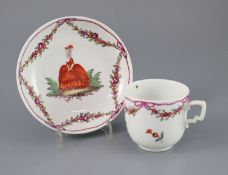 A Vienna coffee cup and saucer, c.1760, painted with a lady and gentleman and floral swags,