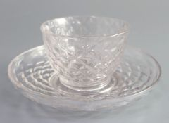 An unusual George II glass tea bowl and saucer, second quarter 18th century each honeycomb