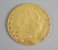 A George III gold guinea, 1794, fifth laureate head, 'spade shield'