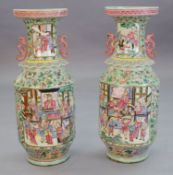 A pair of large Chinese celadon ground famille rose two handled vases, second half 19th century,