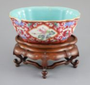 A Chinese ruby ground jardiniere, Daoguang mark and of the period (1821-50), of ruyi head outline,