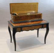 A 19th century Swiss Nicole Freres table musical box, with movement playing five interchangeable