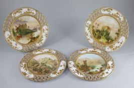 A set of seventeen Coalport topographical dessert plates, c.1880, eleven painted with British and