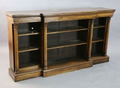 A William IV rosewood dwarf bookcase, with moulded top and four foliate capped columns dividing
