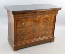 A 19th century French flame mahogany commode, with black granite top, divided frieze drawer and