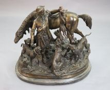 After Pierre Jules Mene. A bronze group of a ghillie, pony and hounds, width 23in. height 20in.