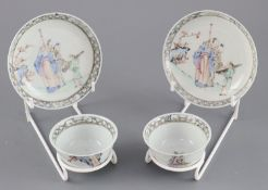 A pair of Chinese famille rose 'sages tea bowls and saucers, Qianlong period, each painted with