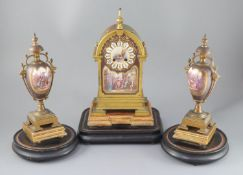 A 19th century French ormolu and enamelled porcelain clock garniture, the eight day clock with