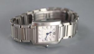 A lady's modern stainless steel Cartier Tank quartz wrist watch with diamond set numerals, with