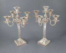 A pair of late Victorian silver corinthian column four branch, five light candelabra by Carrington &
