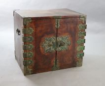 An Indo-Dutch satinwood and brass mounted cabinet, Batavia 1650-1680, the exterior with scrolling