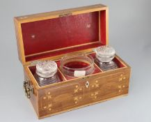 A Regency inlaid mahogany tea caddy, of plain rectangular form, with gilt bronze handles, the lid
