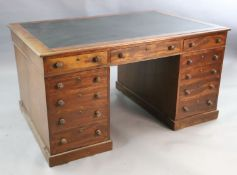 A Victorian mahogany twin pedestal partner's desk, with black leather skiver and eleven drawers