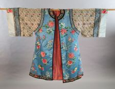 A Chinese embroidered silk robe, late 19th/early 20th century, embroidered with flowers, fruit and