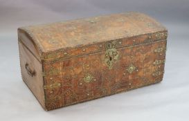A 17th century Russian leather travelling trunk, the domed top with brass studded decoration forming