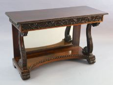 An early 19th century Anglo Indian padouk wood console table, with foliate carved frieze, front