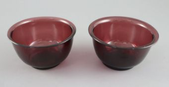 A pair of Chinese Beijing aubergine glass bowls, probably Qing dynasty, 10.5cm diameterCONDITION:
