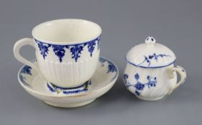 A St. Cloud cup and trembleuse saucer, c.1725-1740 and a Chantilly custard cup and cover, c.1750,