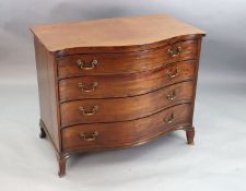A George III serpentine mahogany dressing chest, fitted four graduated long drawers, the top