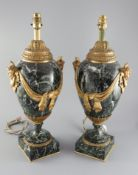 A pair of early 20th century ormolu green marble table lamps, with ovular form with mask lug handles