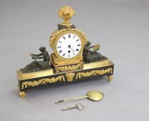 Thos. Hawley, 75 Strand, London. A Regency bronze and ormolu mantel timepiece, with central drum
