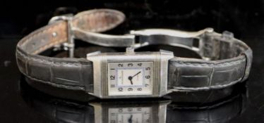 A lady's stainless steel Jaeger LeCoultre Reverso quartz wrist watch, on leather strap with Jaeger