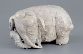 A Chinese burnt jade figure of an elephant, standing turning its head to dexter, 15.5cm