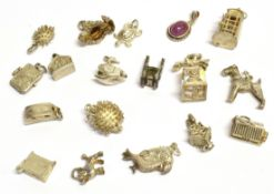 A SILVER CHARM BRACELET And eighteen loose silver charms together with five assorted silver