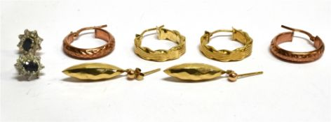 THREE PAIRS OF ASSORTED 9CT GOLD EARRINGS comprising two pairs of hoops and a pair of drop torpedo