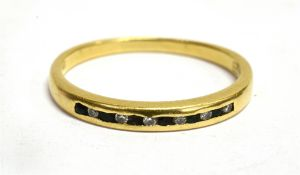 AN 18CT YELLOW GOLD BAND RING Channel set to front with six small diamonds alternating with small