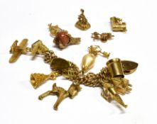 A 9CT GOLD CHARM BRACELET With padlock fastener and eleven assorted charms; together with six