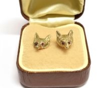 A C1950'S PAIR OF 9CT GOLD FOX HEAD STUD EARRINGS Set with ruby eyes, each with 9ct gold fineness