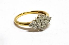 A DIAMOND MARQUISE SHAPED CLUSTER YELLOW GOLD RING a total of sixteen small illusion set diamonds,