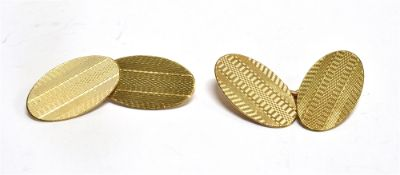 A PAIR OF 9CT GOLD OVAL CHAIN LINKED CUFFLINKS with engine turned finish, hallmarked for 1958,