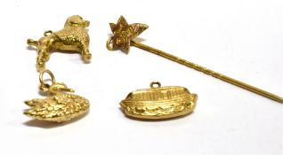 THREE 9CT GOLD LOOSE CHARMS and a 9ct gold three legged Manx stick pin, the charms comprising a